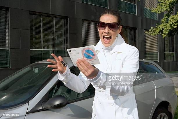Woman Discovering a Parking Ticket