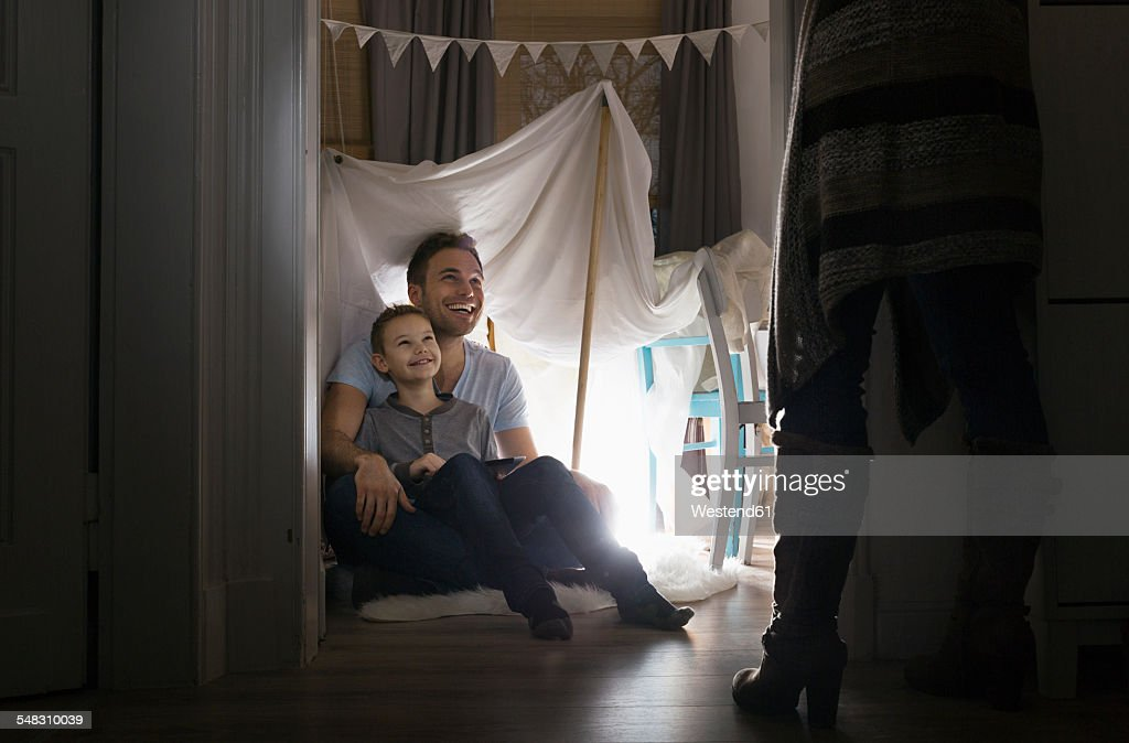 Woman discovering husband and son in self-made tent at home  Stock Photo & Woman Discovering Husband And Son In Selfmade Tent At Home Stock ...