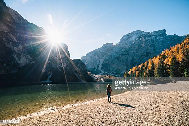 Woman discovers lake in mountains, autumn