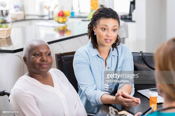 Woman discusses her elderly mom's health with a home healthcare professional