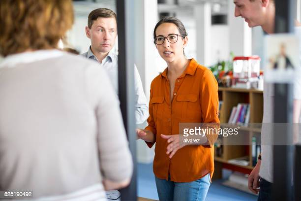 woman discussing business strategy with her team - explaining stock pictures, royalty-free photos & images