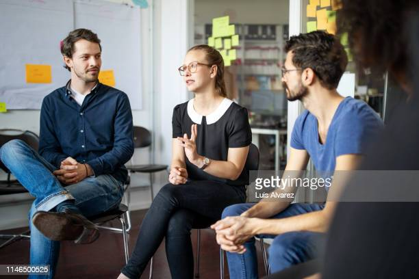 woman discussing new strategies with team - 18 19 years stock pictures, royalty-free photos & images