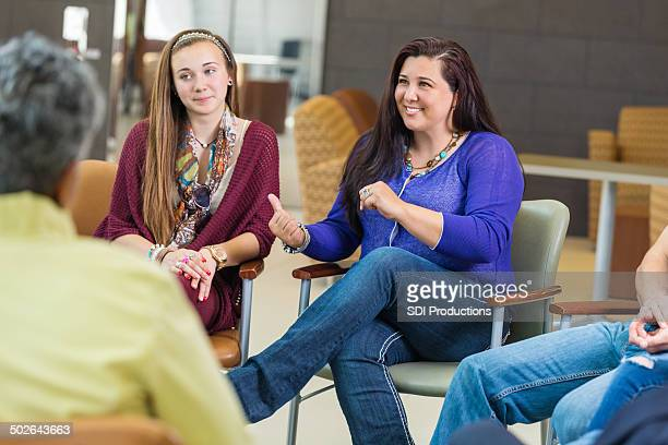 Woman discussing something with diverse group of people