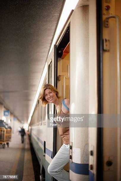 Woman Disembarking a Train