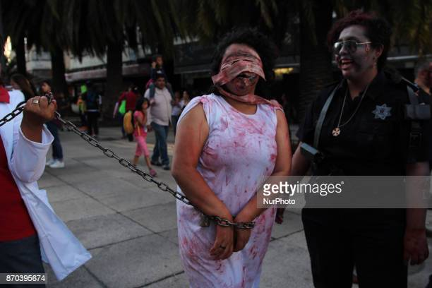 A woman disguised as a Zombie during the annual procession of zombies in Mexico City on November 4 2017 Hundreds dressed in rags and ghoulish makeup...