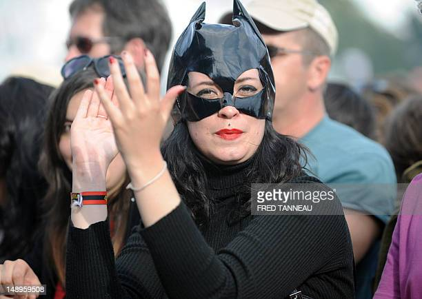 A woman disguised as Catwoman attends the 21st edition of the Vieilles Charrues music festival on July 20 2012 in CarhaixPlouguer western France The...