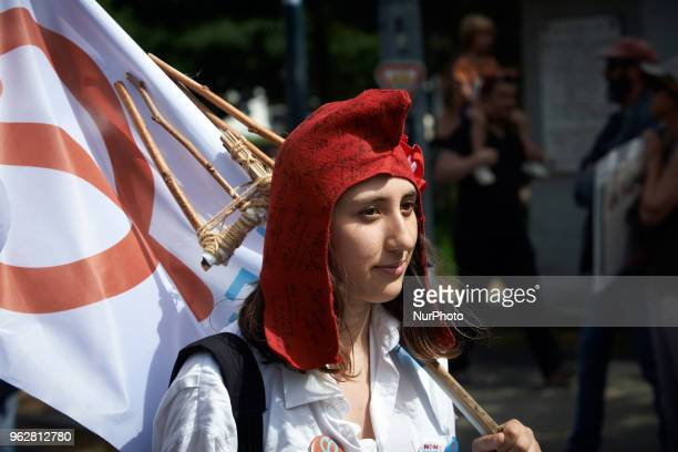A woman disguised as Marianne with the phrygien cap walks A quotmaree populairequot demonstration was called by more than 60 political organisations...