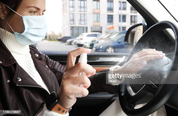 woman disinfecting her car - antiseptic wipe stock pictures, royalty-free photos & images