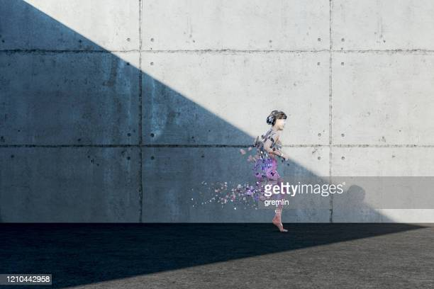 woman disintegrating while running - destruction stock pictures, royalty-free photos & images