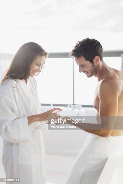 Woman dispensing moisturizer in manês hand