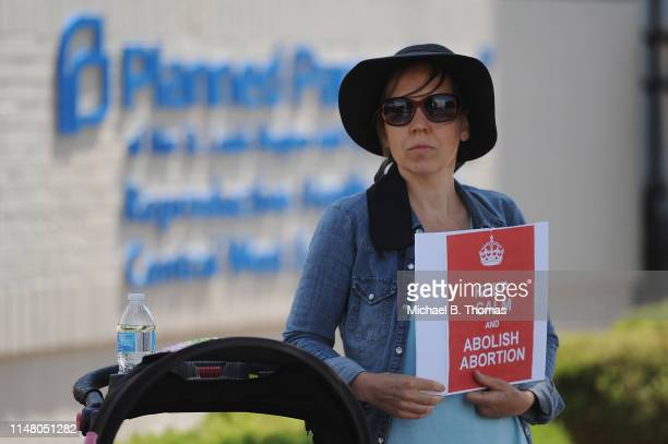 A woman displays a sign in support of abortion legislation during a prolife rally outside the Planned Parenthood Reproductive Health Center on June 4...