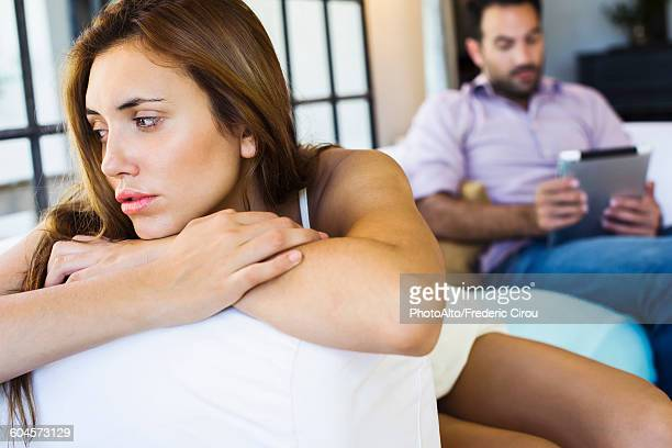 woman displeased by boyfriend on digital tablet - dismissal stock photos and pictures