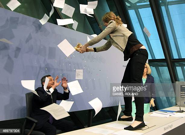 Woman disrupts a press conference by Mario Draghi , President of the European Central Bank by throwing confettis following a meeting of the Governing...