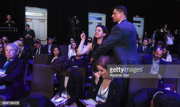 Woman disrupts Fox News journalist Dana Marie Perino and Scott Pruitt, administrator of U.S. EPA during a one-on-one conversation at The 2017...