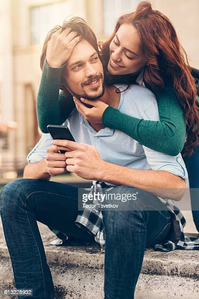 Woman distracting her man from texting
