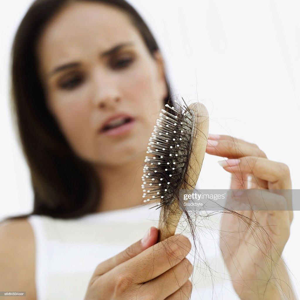 woman distraught at hair loss : Stock Photo