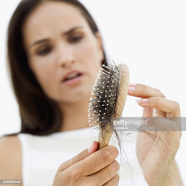 woman distraught at hair loss - bald woman stock photos and pictures