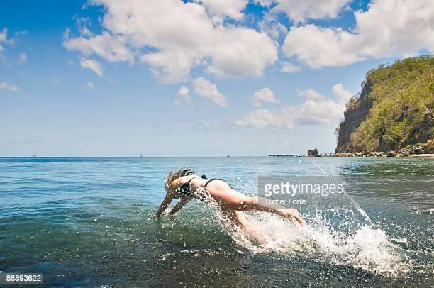 Woman dives into ocean