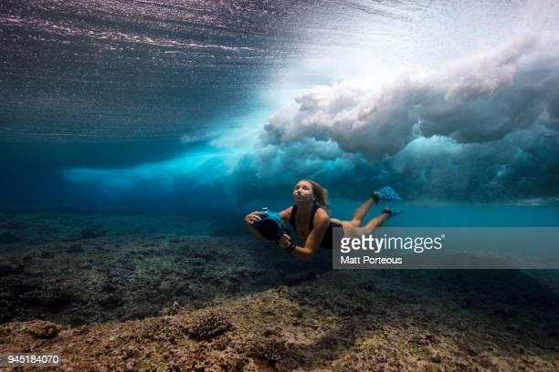 Woman dives with underwater camera