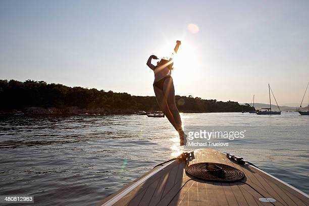 Woman diving from boat, Cannes Islands, Cote D'Azur, France