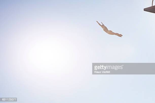 Woman diving from platform