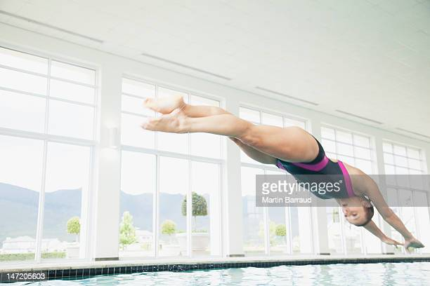 Woman diving in swimming pool
