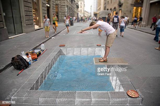 woman diving into caulk sidewalk drawing