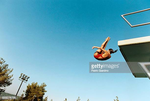 woman diving into pool - diving platform stock pictures, royalty-free photos & images