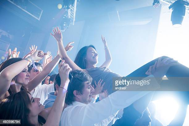 Woman diving into the crowd at a concert