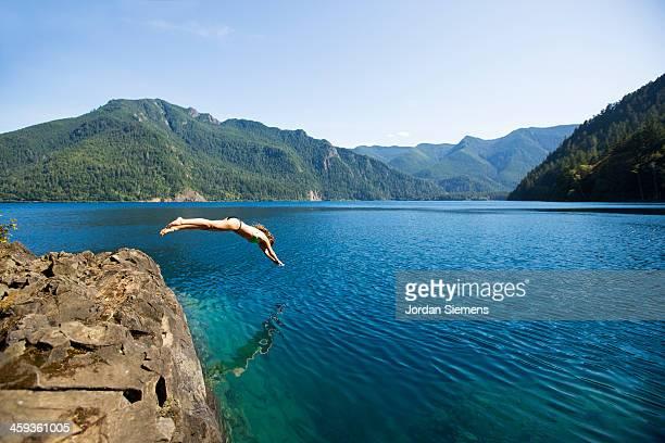 Woman diving off a rock