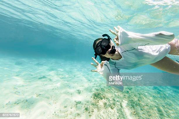 Woman Diving Underwarter Signing OK to the Camera