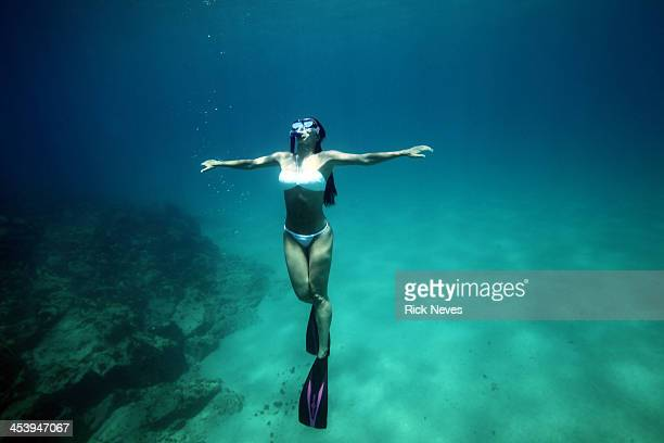 Woman diving with open arms