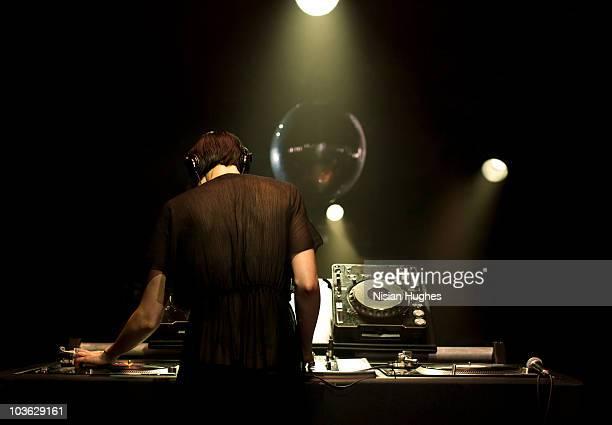 Woman DJ on turntables