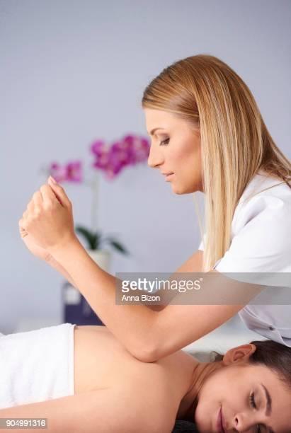 woman do professional back massage. debica, poland - massaggio sensuale foto e immagini stock