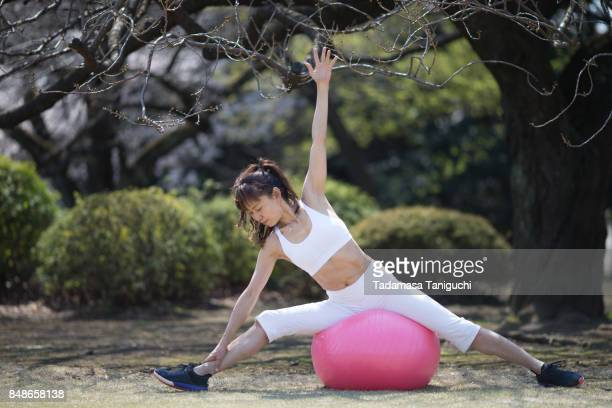 Woman do stretching exercise in the park