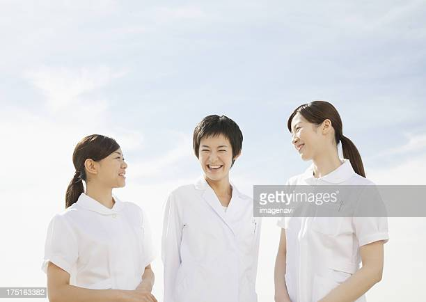 Woman doctor and nurse smiling