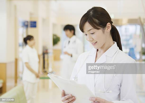 Woman doctor checking the medical chart