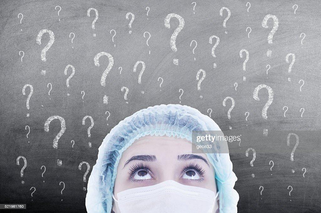 woman doctor thinking on blackboard : Stock Photo