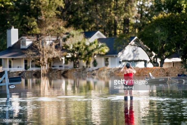 Woman documents floodwaters caused by Hurricane Florence near the Waccamaw River on September 23, 2018 in Conway, South Carolina. Floodwaters are...