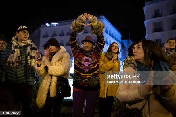 A woman does a feminist symbol with her hands during a demonstration at the start of International Women's Day in Puerta del Sol Square on March 08...