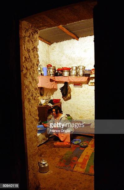 A woman does chores in the kitchen of her home April 14 2004 in Bni Meskine central Morocco about an hour inland by car from Casablanca Inhabitants...
