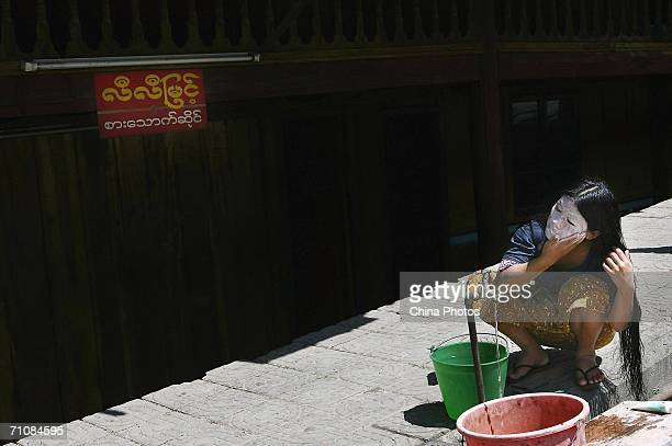 A woman does facial at a street on March 19 2006 in Panwa Kachin State Special Region 1 of Kachin State Myanmar The Kachin State Special Region 1...