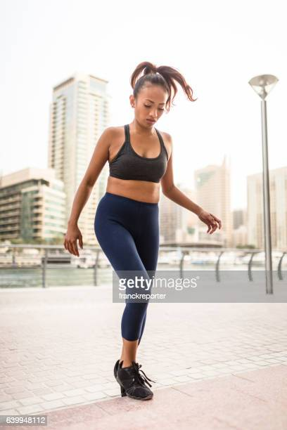 woman doing a exercise in dubai marina