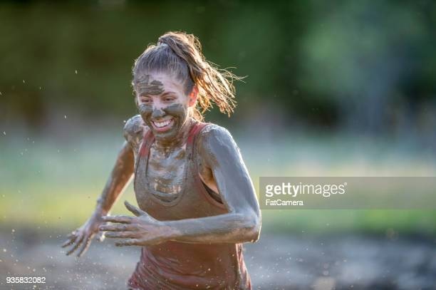 woman doing a mud run - mud stock pictures, royalty-free photos & images