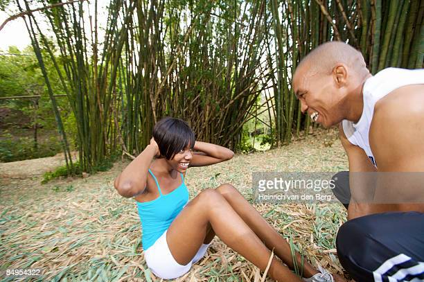 woman doing a sit-up in bamboo forest. pietermaritzburg, kwazulu-natal province, south africa - pietermaritzburg stock pictures, royalty-free photos & images