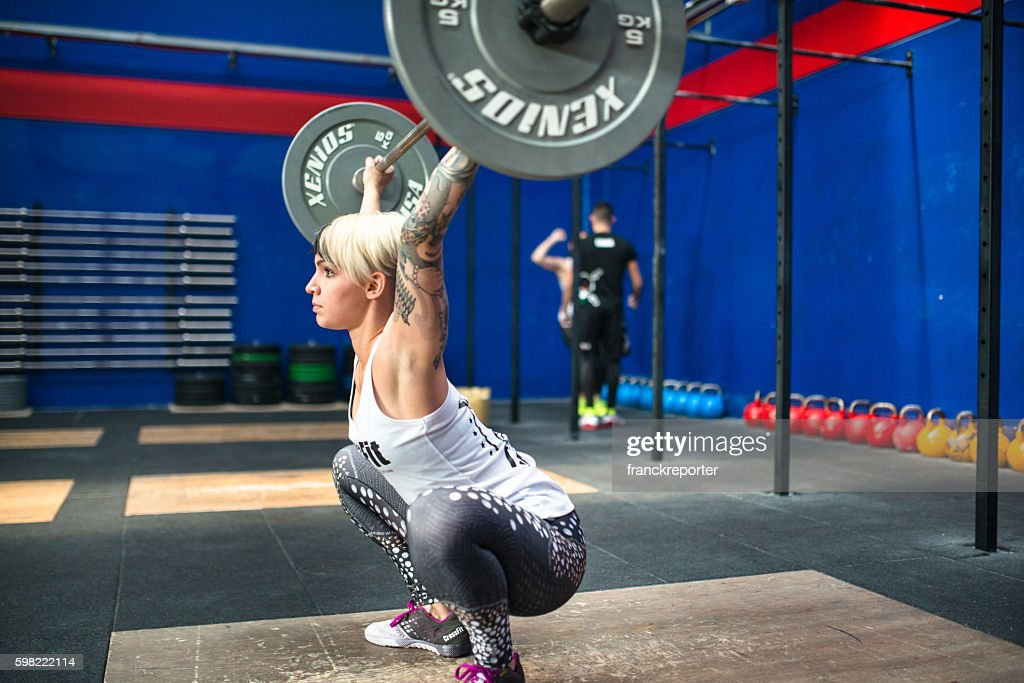 woman doing a strong training gym weightlifting : Stock Photo