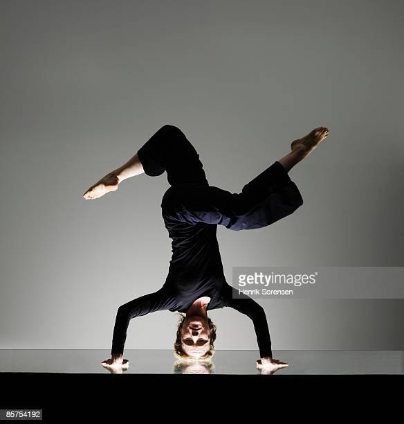 Woman doing a yoga headstand.