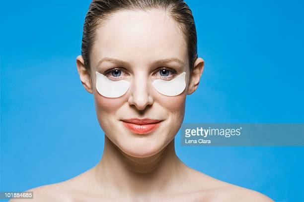 A woman doing an eye treatment
