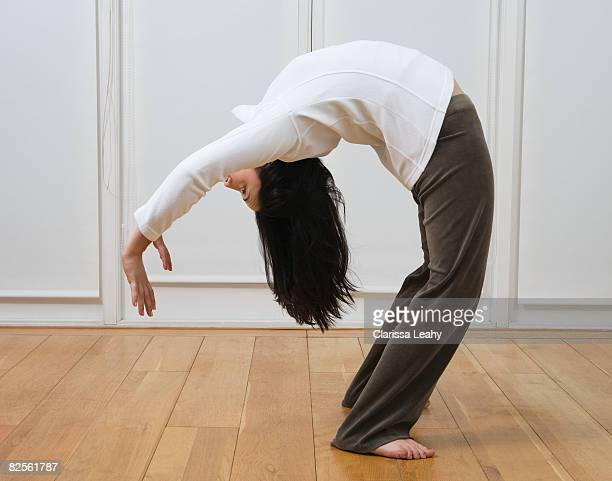 woman doing back bend - bending over backwards stock photos and pictures