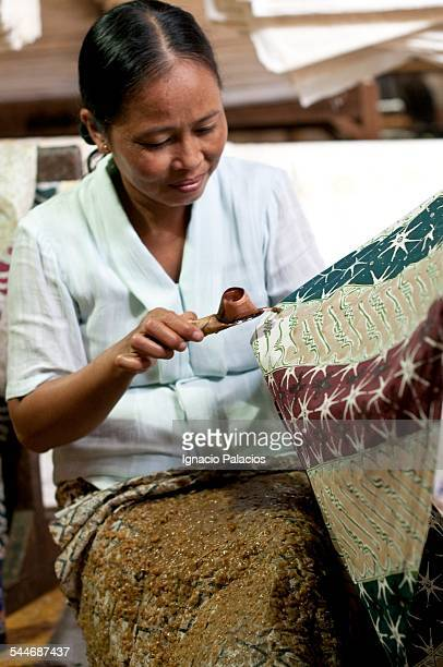 Woman doing batik in Solo, Java, Indonesia